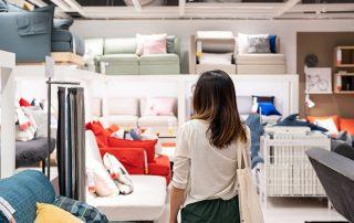Young woman choosing furniture
