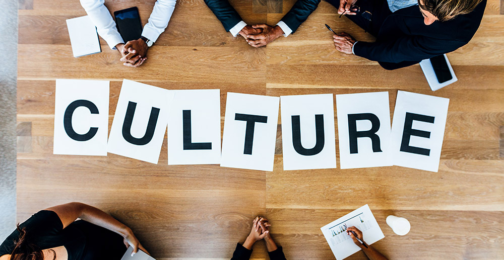 Business people in meeting develop a positive work culture
